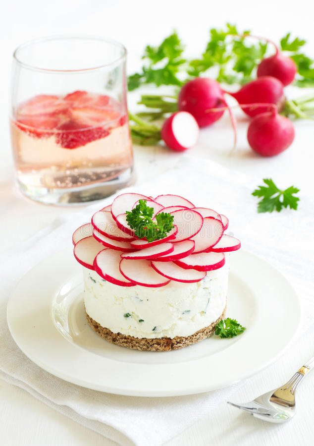 Snack-cheesecake made from cottage cheese. With onions and radishes stock image
