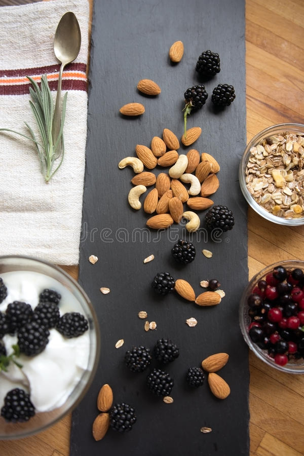 Snack with fresh berries, blueberries and almonds stock images