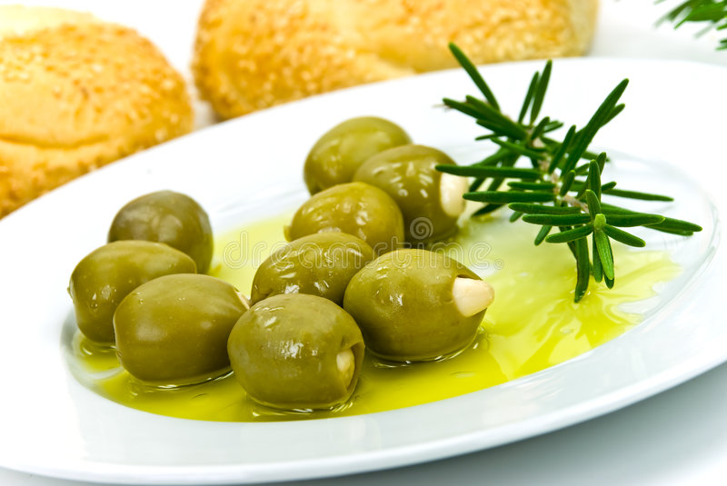 Snack with fresh olives,oil and sesame bun royalty free stock photo