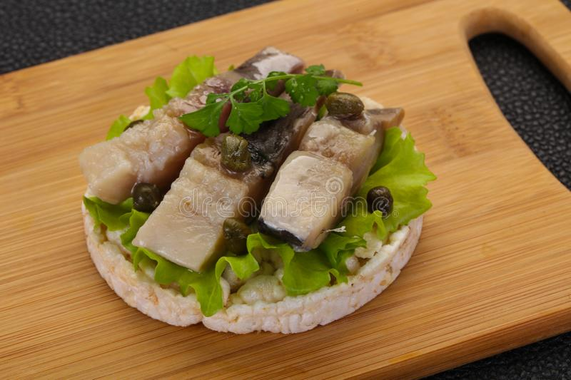 Snack with herring royalty free stock image