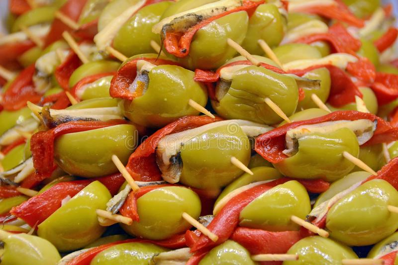 Snack with olives fish and peppers royalty free stock photos