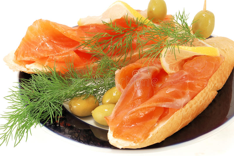 Snack from a salmon. Sandwiches with a smoked salmon on a white background stock photos