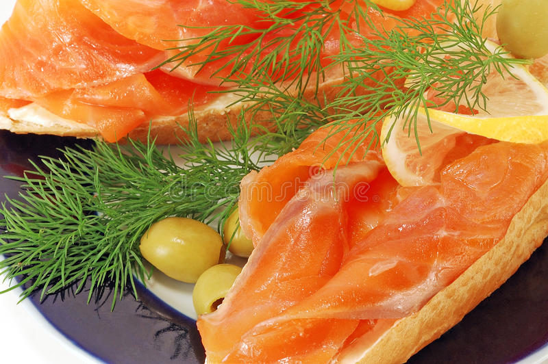 Snack from a salmon. Sandwiches with a smoked salmon on a white background royalty free stock image