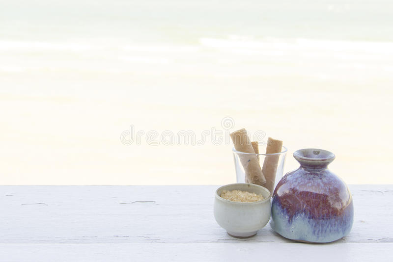 Snack set in different ware rest by the beach stock images