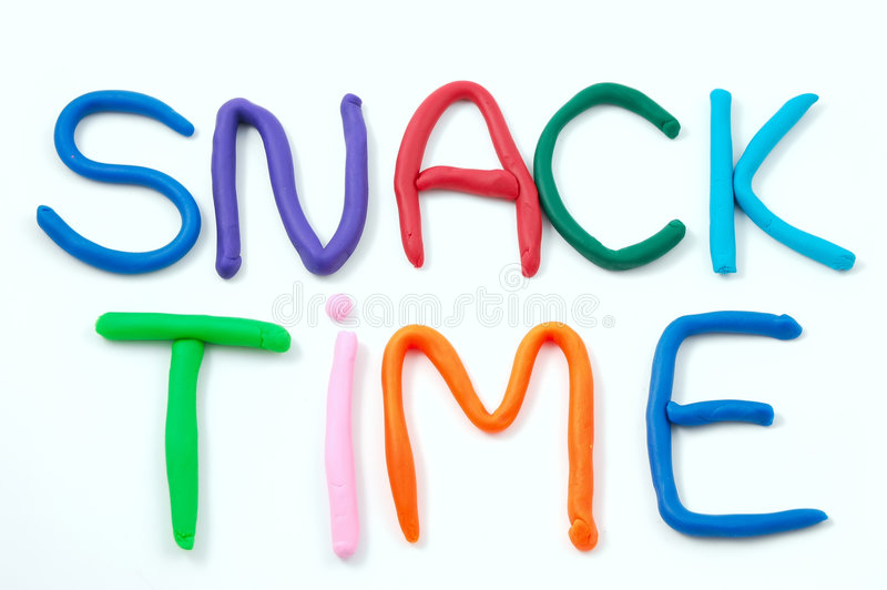 Snack Time. Spelled out using child's clay isolated on a white background stock images