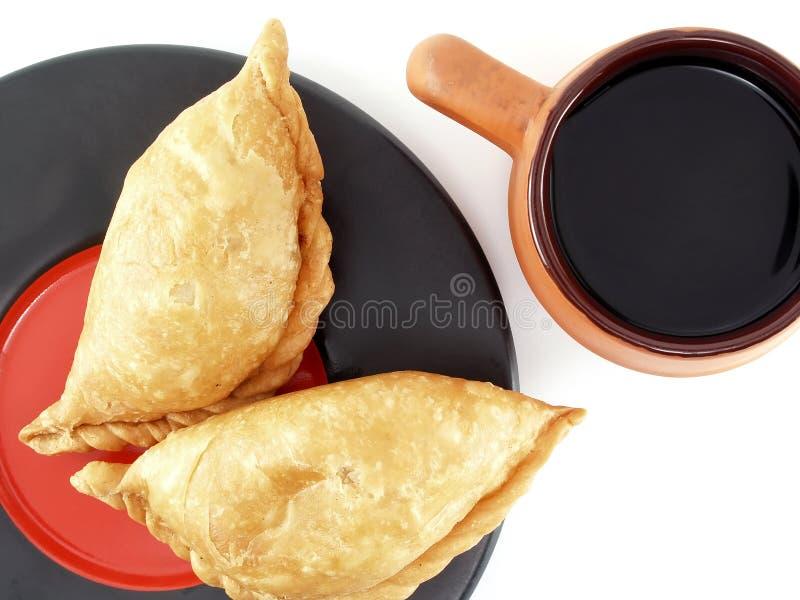 Snack und Lebensmittel mit schwarzem Kaffee stockfotos