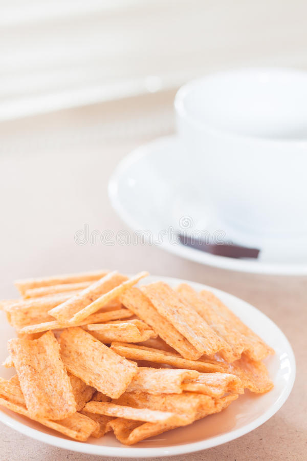Snack on white plate with coffee cup. Stock photo royalty free stock photo