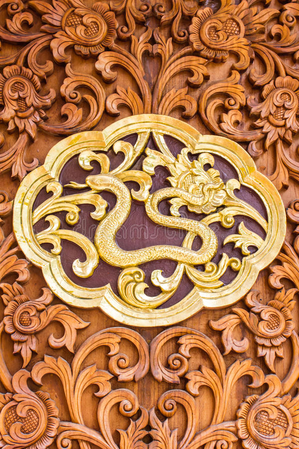 Snack Wood Carving Wall Sculptures In Thai Temple Stock Photo ...