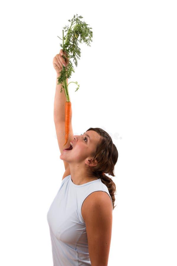Snacking en una zanahoria fotografía de archivo libre de regalías