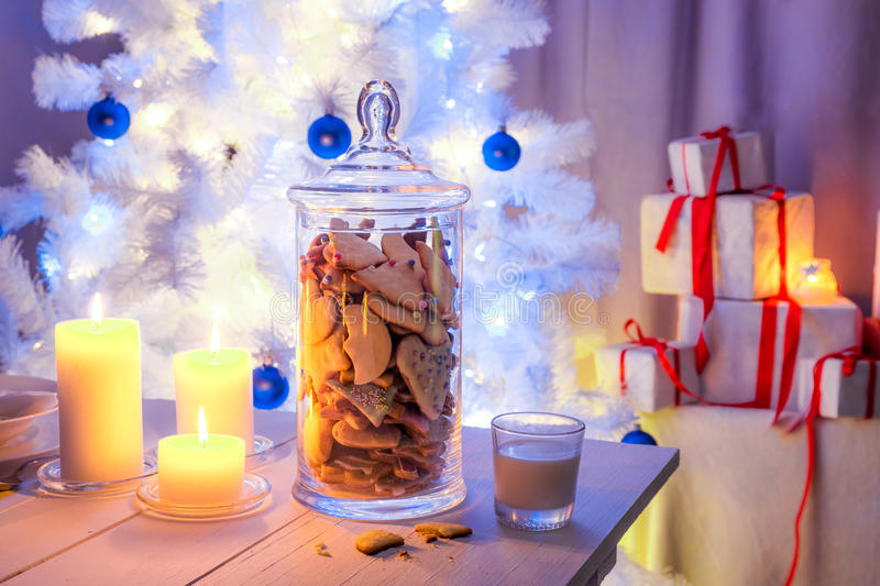 Snacking gingerbread cookies with milk for Christmas Eve. Blue and white style stock photography