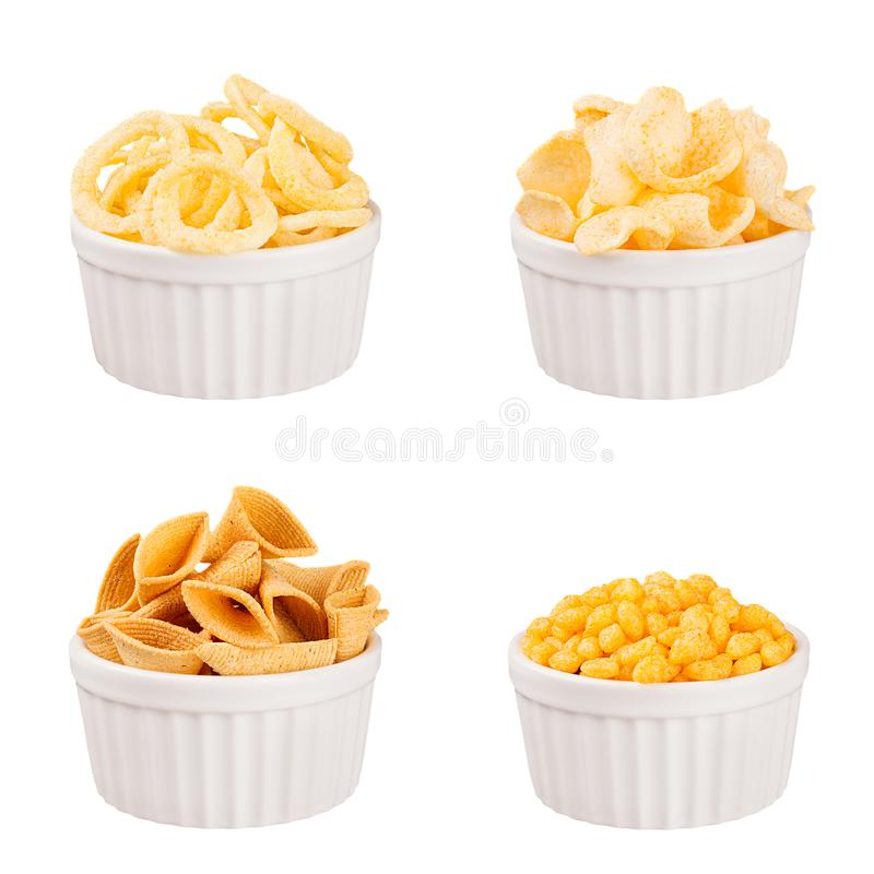 Snacks collection - crunchy different corn sticks in white ceramics bowls, isolated. Fast food template for menu, advertising, cov. Er stock images