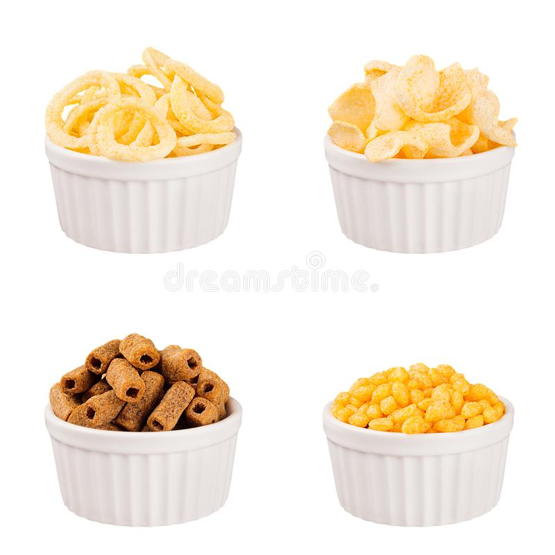 Snacks collection - crunchy different corn sticks in white ceramics bowls, isolated. stock images