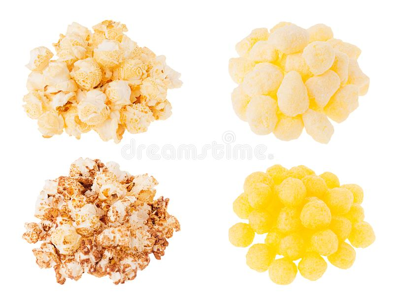 Snacks collection - different popcorn and corn sticks in heaps isolated on white background. stock photography
