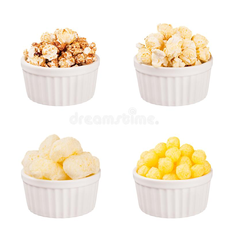 Snacks collection - different popcorn and corn sticks in white ceramics bowls, isolated. stock photo
