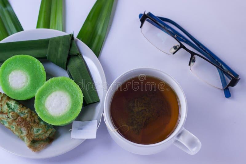 Snacks with green tea stock image