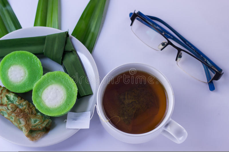 Snacks with green tea royalty free stock image