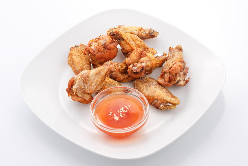 Snacks, kippenvleugels met zoete Spaanse peperssaus royalty-vrije stock foto