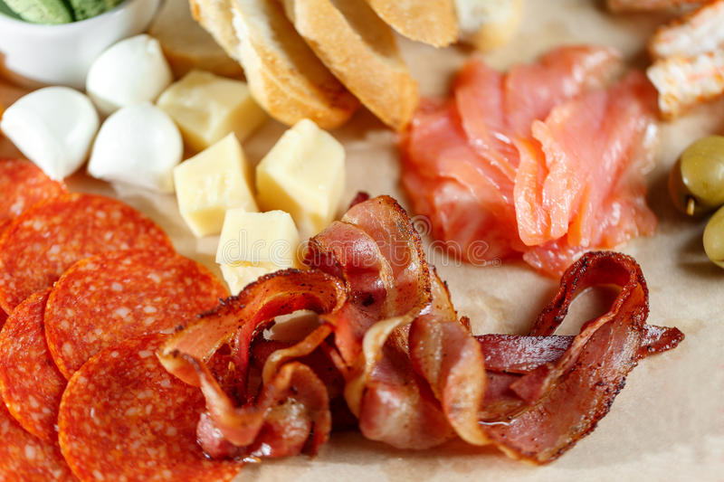 Snacks. meat and cheese plate in the restaurant. traditional Italian appetizer - antipasti royalty free stock photo
