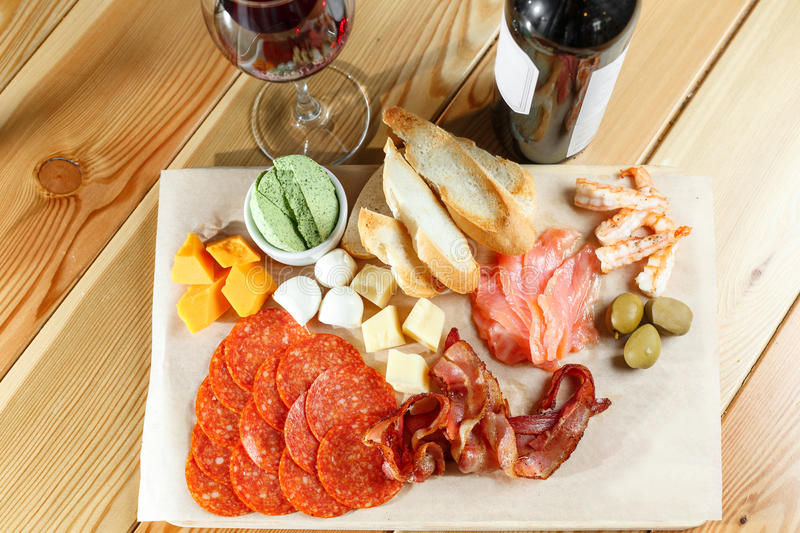 Snacks. meat and cheese plate in the restaurant. traditional Italian appetizer - antipasti stock images