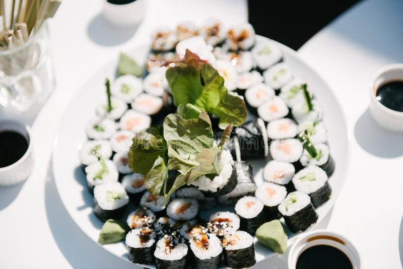 Snacks on a plate on the table royalty free stock image