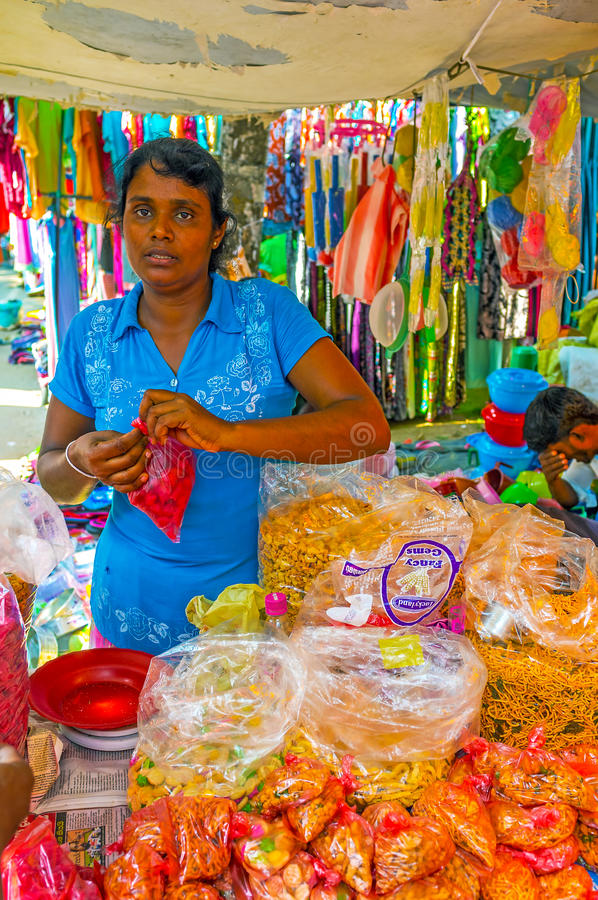 Snacks of Sri Lanka. WELLAWAYA, SRI LANKA - DECEMBER 2, 2016: The snack stall in market offers wide range of snacks such as nuts, crackers, noodles, fried dough royalty free stock image
