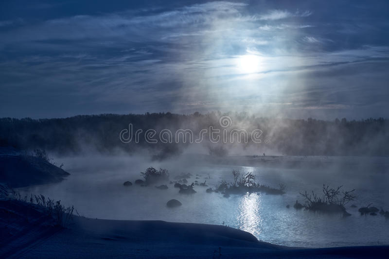Snags in the river water in winter Moon night royalty free stock photography