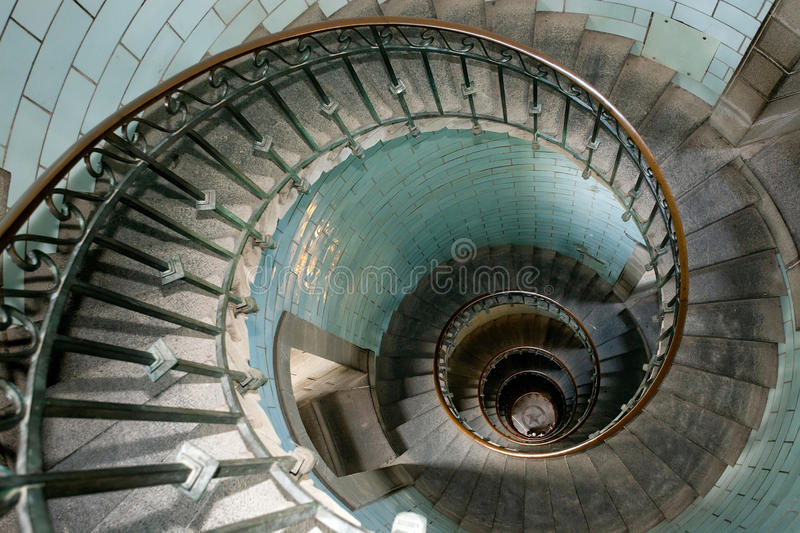 Snail lighthouse staircase. High luxurious lighthouse staircase with metal guardrail and opaline walls, Eckmul Brittany royalty free stock photo