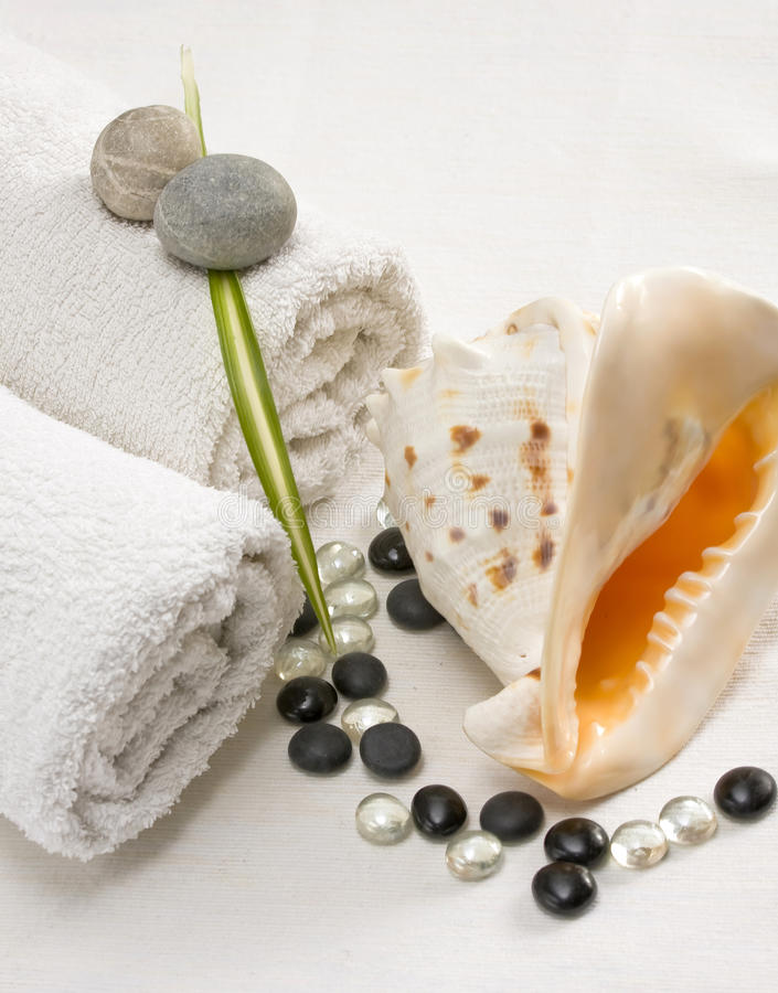 Beside a snail shell clear towels,shining pebbles royalty free stock photo
