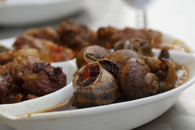 Snails as Tapas royalty free stock images