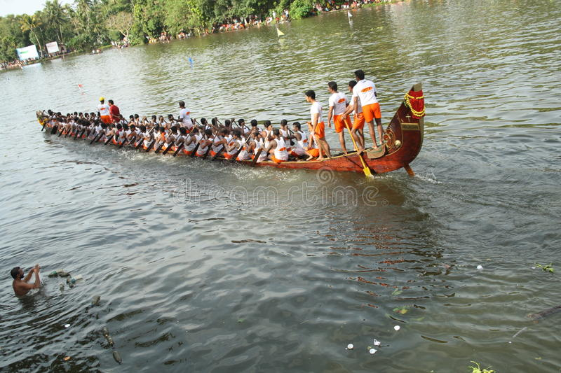 Snake boat with people. Long snake boat with people participating in the Nehru trophy boat race of Alleppey in Kerala, India stock photos