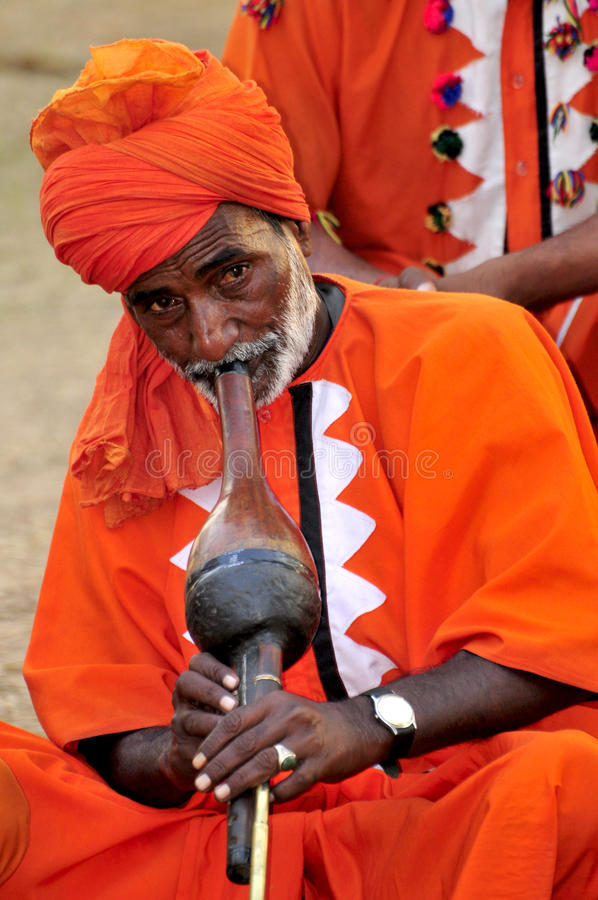 Snake charmer. Playing his musical instrument 'been royalty free stock images
