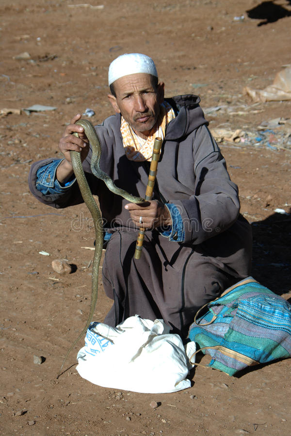 The snake charmer. This is a snake charmer near Marrakech. He was in a open air market in Tahnnout on the way to the Atlas Mountain Range stock photos