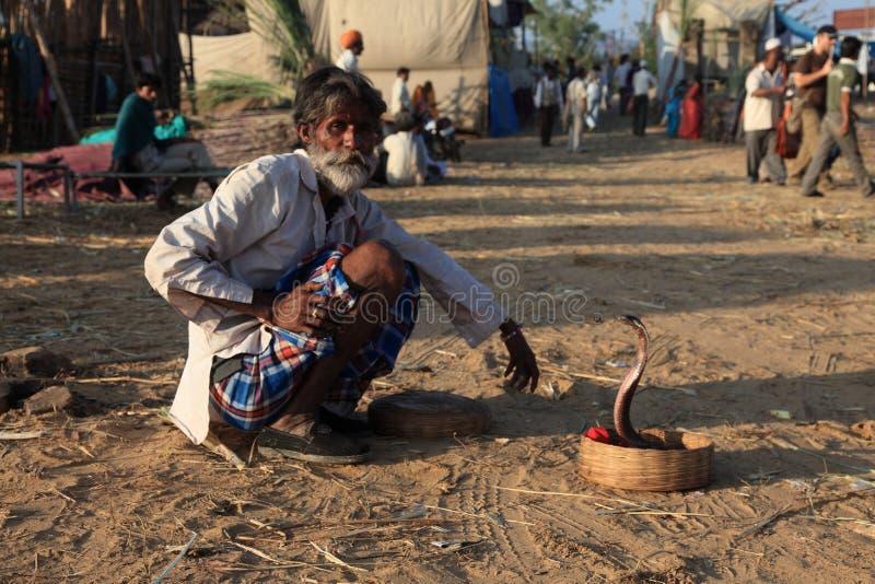 Snake charmer. A Snake charmer with his snake at Pushkar Fair, Rajastan, India royalty free stock photo
