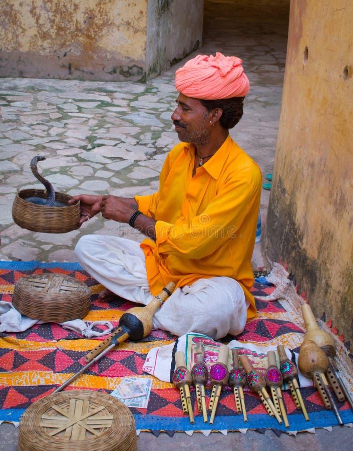 Snake charmer in Amber Fort ,Jaipur, India. JAIPUR, INDIA-SEPT 26 : Snake charmer in Amber Fort Sept 26, 2013 in Jaipur, India. Performance of snake charmers is stock image
