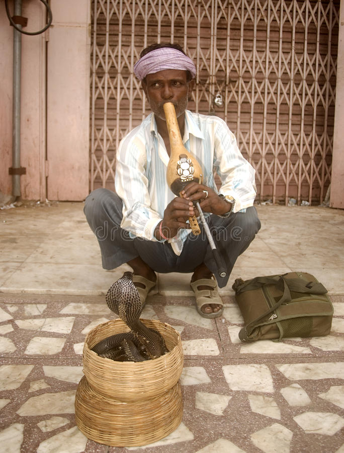 Snake charmer, Jaipur, India. Snake charmer performs in front of Jaipur Palace in Rajasthan, India royalty free stock image