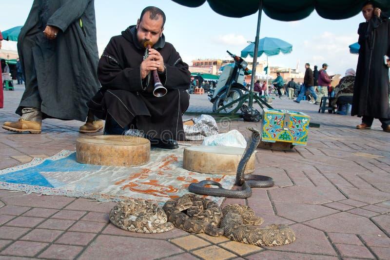 Snake charmer. MARRAKESH, MOROCCO - JANUARY 27: Snake charmer at Djemaa el Fna square. January 27, 2010 in Marrakesh, Morocco stock photos