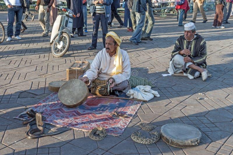Snake charmer n Marrakesh. Snake charmer at the Jemaa el-Fnaa square in Marrakesh. November 22, 2008 in Marrakesh, Morocco royalty free stock photo