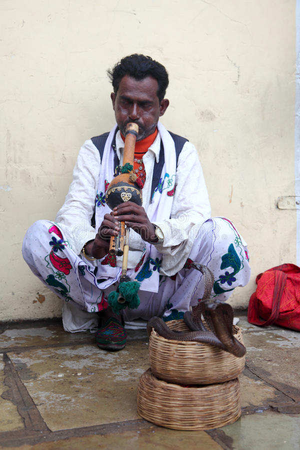 A Snake charmer. Performs in front of Jantar Mantar on November 17, 2010 in Jaipur, Rajasthan,India. Snake charming is a folk art performed widely in India stock photo