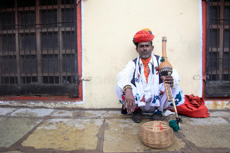 A Snake charmer performs in front of Jantar Mantar. On November 17, 2010 in Jaipur, Rajasthan,India. Snake charming is a folk art performed widely in India royalty free stock photography