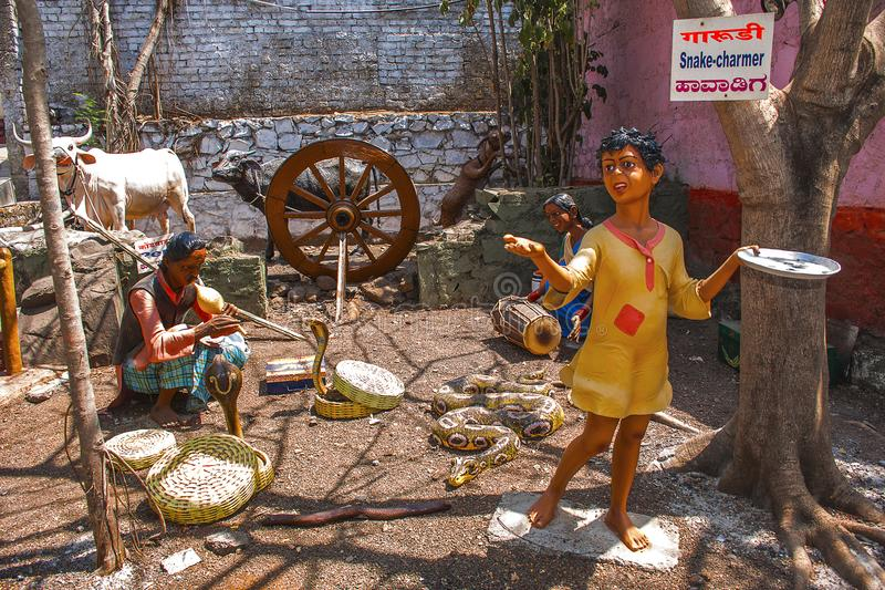Snake charmer, sculpture museum, Kaneri Math, Kolhapur, Maharashtra. Snake charmer, sculpture museum, Kaneri Math at Kolhapur, Maharashtra royalty free stock photography