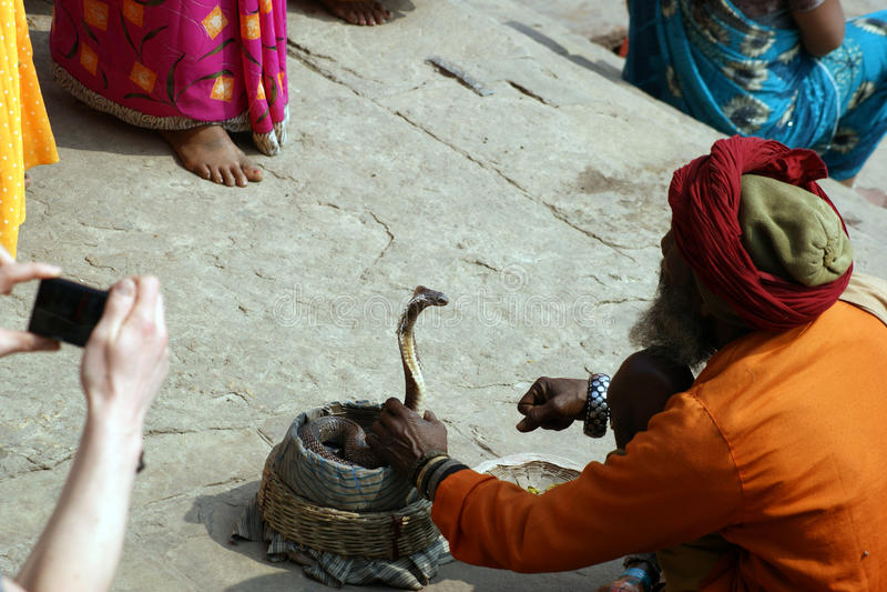 Snake charmer in Varanasi, India. Snake charmer on street in holy city of Varanasi, India stock photos