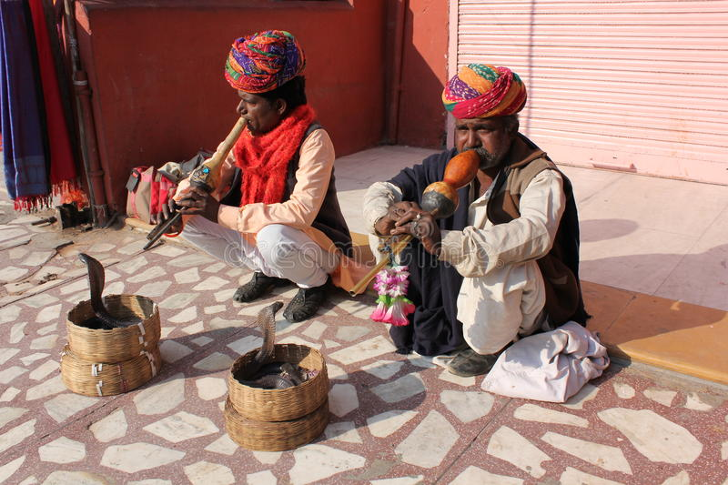 Snake charmers. Two snakes charmers by the roadside in Jaipur street, India stock image