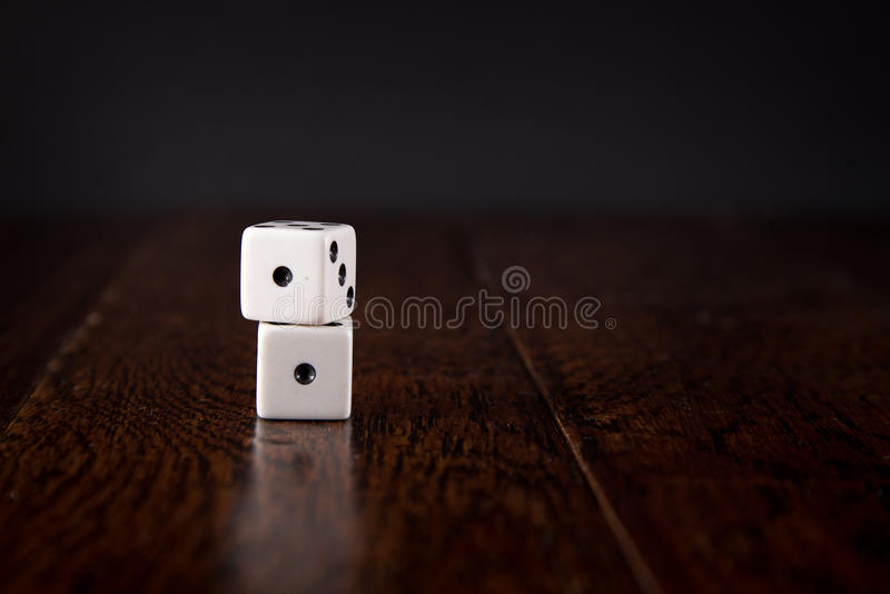 Snake Eyes - Dice on Wood Table Background royalty free stock photos