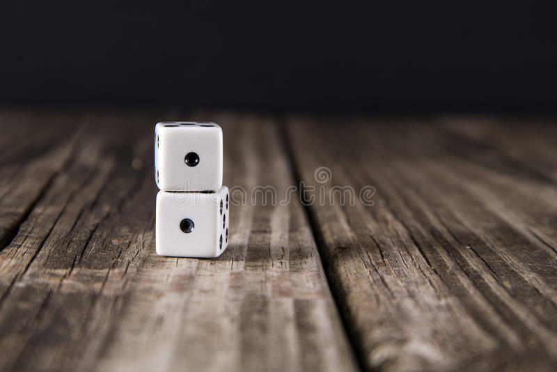 Snake Eyes - Dice on Wood Table Background royalty free stock images
