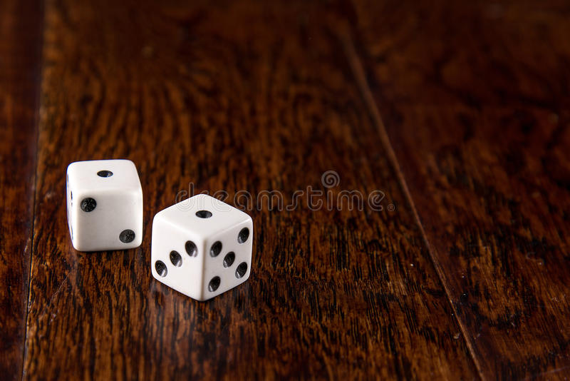 Snake Eyes - Dice on Wood Table Background royalty free stock photography