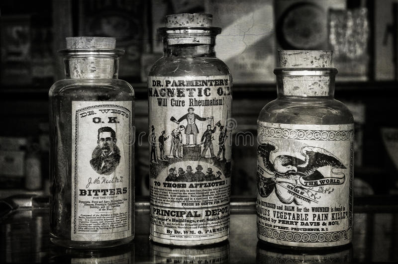 Snake Oils - Old Time Treatments. Medicines to cure just about anything, especially money afflictions - aged image stock photos