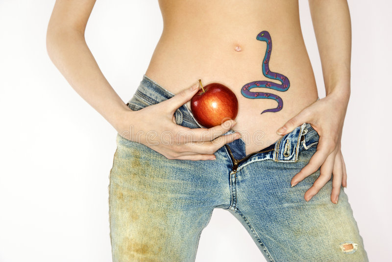 Snake tattoo and apple. stock photos
