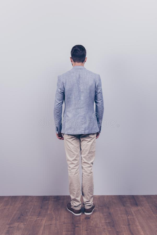 Snap model shot. Full length photo, rear view, guy in a formal w royalty free stock image