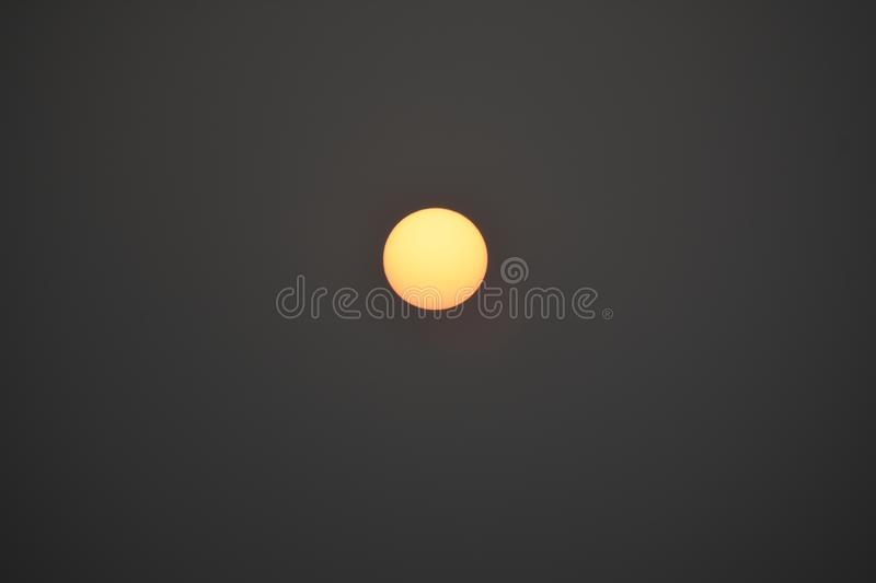 Snap of Rising Sun clicked in Golden Hour. Snap of orange Rising Sun clicked in Golden Hour with city-scope stock images