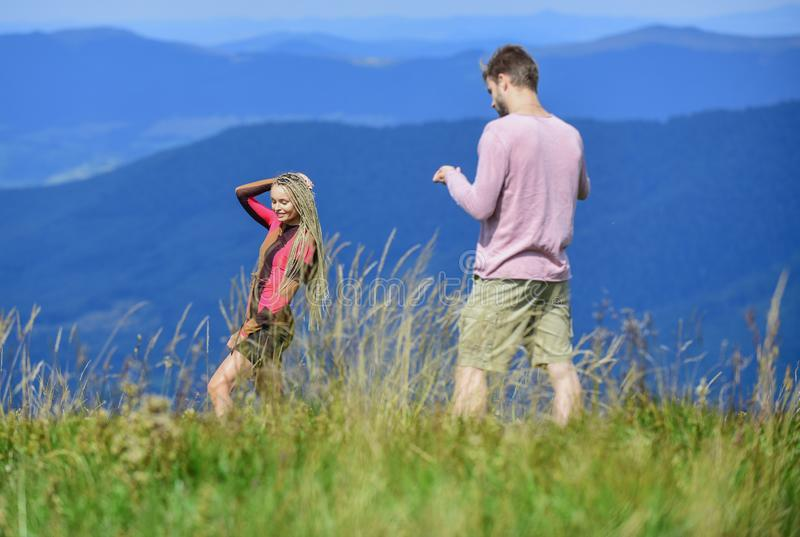 Snapping memories. Man and woman posing mobile photo. Lets take photo. Summer vacation concept. One more shot. Travel. Snapping memories. Man and women posing royalty free stock photo